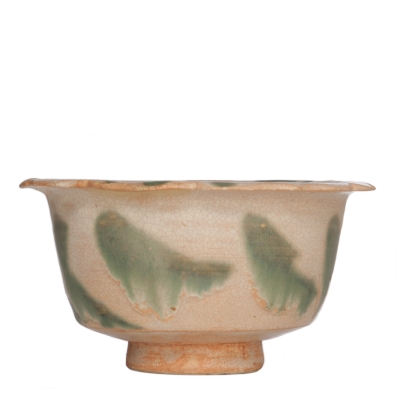 Unusual Chinese pottery bowl with cream-coloured glaze and copper green splashes, from Changsha. The shape is probably based on an Islamic metal eample