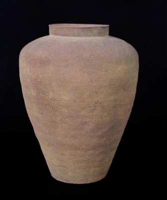 A conical shaped earthenware jar