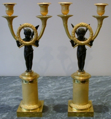 A pair of gilt and patinated candelabra