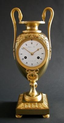 An ormolu gilt bronze pendule.
