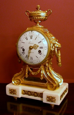A gilt bronze and white marble mantleclock