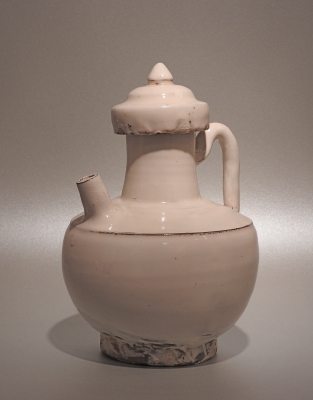 A rare Chinese stoneware ewer and its cover, the body covered with a white slip and a clear glaze.
