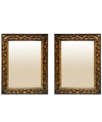 A Pair of Giltwood and Ebonised Mirrors
