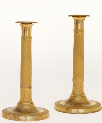 A Pair of Empire Candlesticks in Guilded Bronze