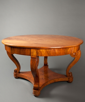 An Exceptional Center Table in Padouk and Amboyna