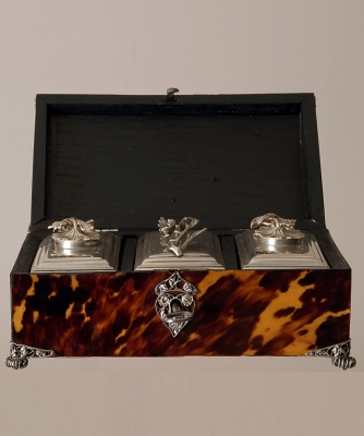 A Tortoiseshell Tea-chest with silver filigree mounts