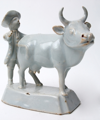 Standing Cow with Farmer in White Delft