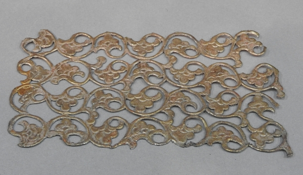 An unusual Chinese gilt metal fragment with floral designs.