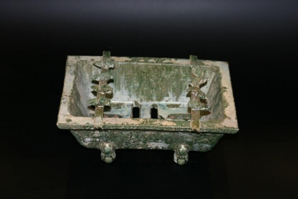 A Chinese green glazed earthenware barbecue with roasting cicadas, Han dynasty ceramics China