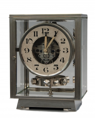 M177 Nickel plated art deco J. L. Reutter four-glass Atmos clock.