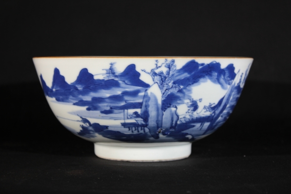 A blue and white porcelain Chinese bowl with landscape design. Qing Dynasty