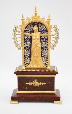 A rare French gilt and enamel 'bras en l'air' mantel clock, circa 1880