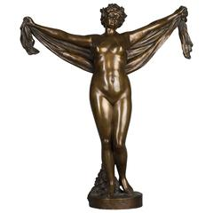 A nice patinated bronze of a nude lady holding a scarf, circa 1880
