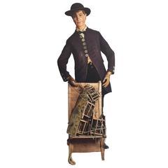An original life-size model of an 19th century clock peddler figure, circa 1880