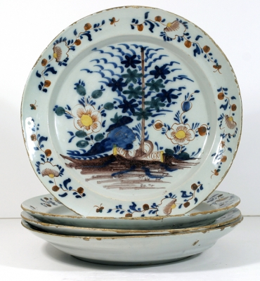 A Set of Four Polychrome Delft Chargers