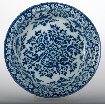 A Deep Charger in Dutch Delftware with a Flower Decoration, The Netherlands,  Circa 1690