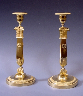 A pair exclusive Russian Empire candlesticks met eagle-heads, circa 1810