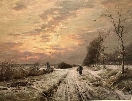 Winterlandscape, late afternoon, walking woman