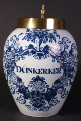 A Dutch Delft blue and white tobacco jar with brass cover, Duinkerker.