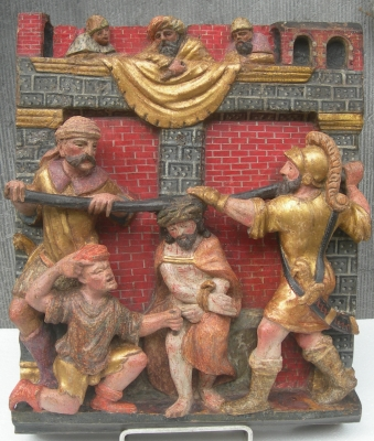 A POLYCHROME CARVED WOODEN RELIEF  1 of 2