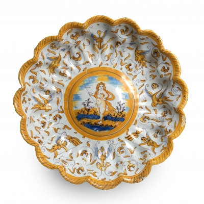 A Dutch maiolica polychrome scalloped plate
