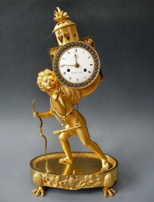 A fine gilt bronze sculptural mantel clock 'The Magic Lantern', by Baudoin à Paris, c. 1800.