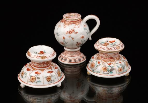 Two Dutch decorated Porcelain Saltcellars and a Mustard Pot, Japan