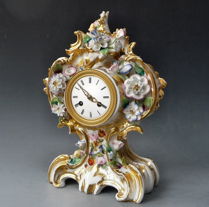 Elegant porcelain Louis Philippe mantel clock, signed Cailly, France c. 1850.