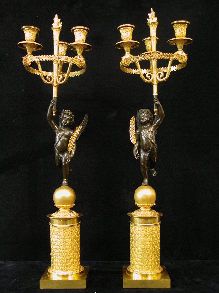A Pair of Two French Empire Gilt and Patinated Bronze Three-Light Candelabra.<br>France, circa 1810.