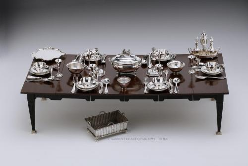 A miniature table set for six with antique Dutch silver miniature silver
