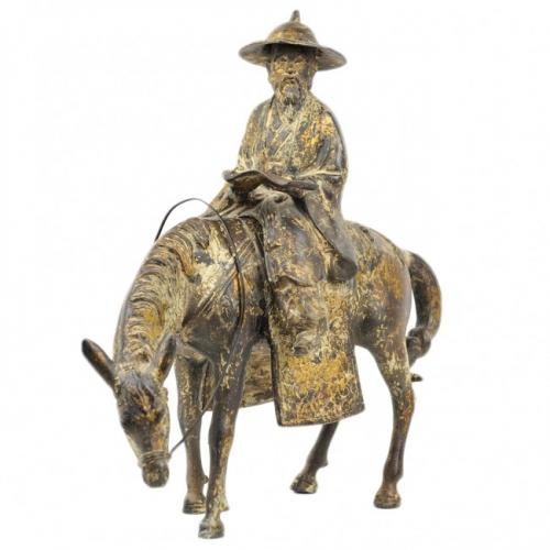 A CHINESE GILT-BRONZE SCULPTURE OF A SCHOLAR RIDING A HORSE